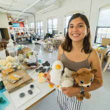 Karime Laborin holds assistive stuffed animals